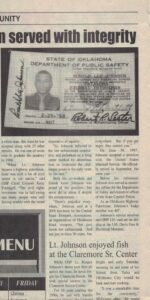 Three columns of article text under image of ID card and partial article title.