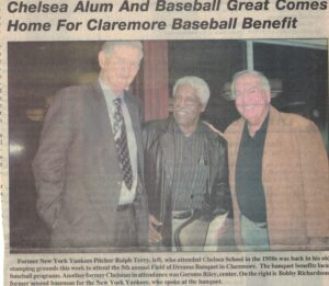 Picture of three men standing together with article title overhead and caption below.
